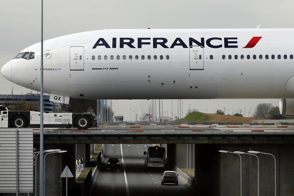 An Air France plane crosses a bridge as he prepares to take off at Paris Charles de Gaulle airport, in Roissy, near Paris, Wednesday, April 11, 2018. About 30 percent of Air France flights scheduled on Wednesday are expected to be canceled as flight crews and ground staff started a seventh day of strike. (AP Photo/Christophe Ena)