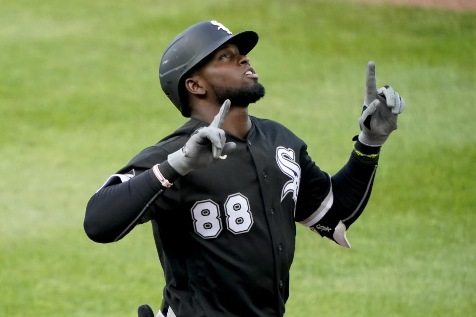 Chicago White Sox's Luis Robert celebrates as he crosses the plate after hitting a solo home run during the second inning of the team's baseball game against the Kansas City Royals on Saturday, Aug. 1, 2020, in Kansas City, Mo. (AP Photo/Charlie Riedel)