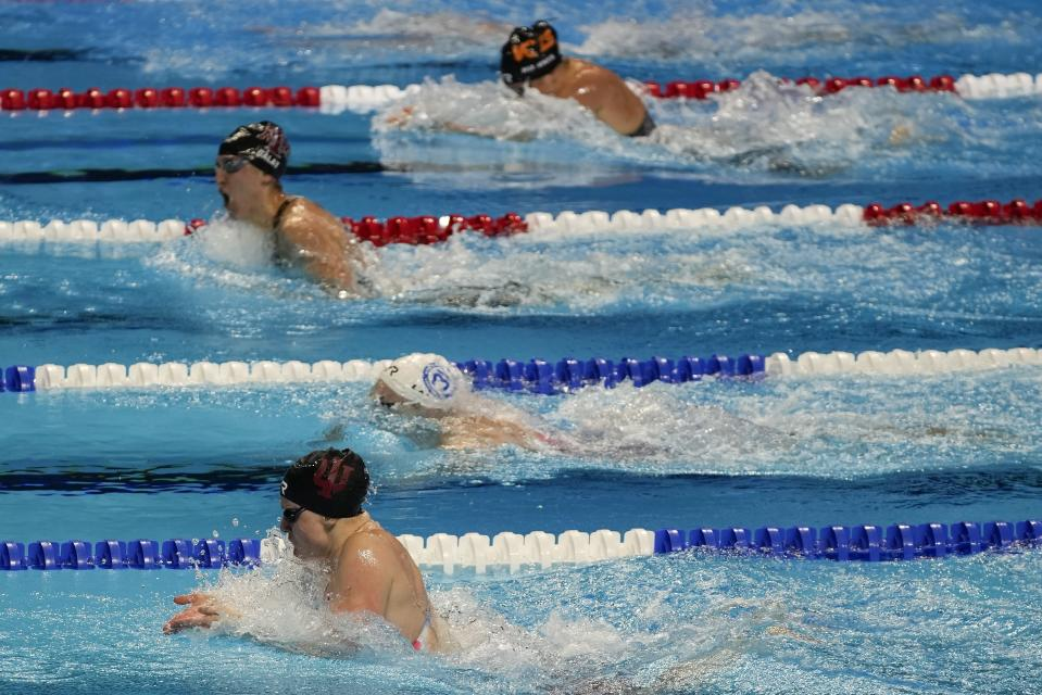 Lilly King participates in the women's 100 breaststroke during wave 2 of the U.S. Olympic Swim Trials on Tuesday, June 15, 2021, in Omaha, Neb. (AP Photo/Jeff Roberson)