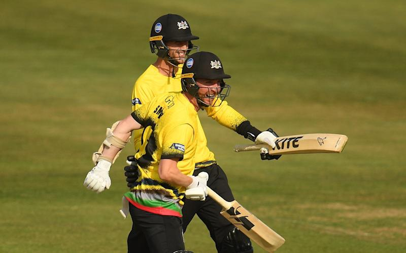 Tom Smith(L) and David Payne of Gloucestershire(R) celebrate as the final ball is hit for four to win the match during the Vitality Blast match between Gloucestershire and Somerset at the Bristol County Ground on September 20, 2020 in Bristol, England. - GETTY IMAGES