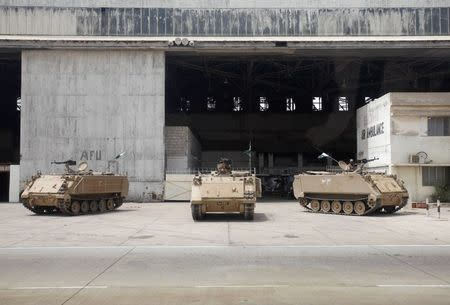 Pakistan Army's armored personal carriers are seen at Jinnah International Airport, after Sunday's attack by Taliban militants, in Karachi June 10, 2014. REUTERS/Athar Hussain