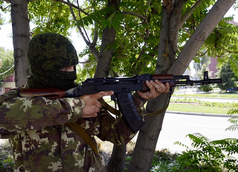 A pro-Russian militant aims a Kalashnikov during the combat with Ukrainian forces in the eastern city of Donetsk on July 21, 2014