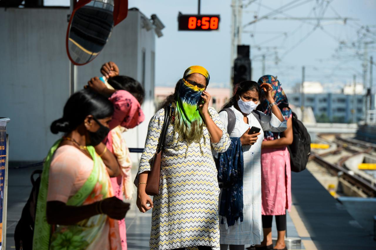Passengers waits for a train following the resumption of metro services after more than five months of shutdown due to the Covid-19 pandemic, at a station in Hyderabad on September 7, 2020. (Photo by NOAH SEELAM/AFP via Getty Images)