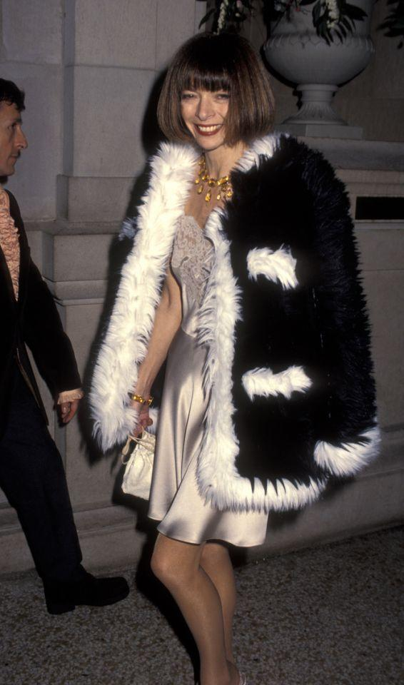 "<p>Her dark lipstick, slip dress, and furry coat are all unmistakably '90s, but her <a rel=""nofollow"" href=""https://www.yahoo.com/beauty/what-it-means-to-give-up-your-signature-hairstyle-101275550553.html"">signature bob</a> is timeless. </p>"