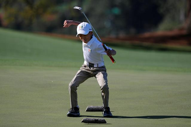 Taighan Chea celebrates sinking his putt to win the Boys 7-9 year old Drive, Chip and Putt National Finals at Augusta National Golf Club in Augusta, Georgia, U.S., April 1, 2018. REUTERS/Brian Snyder