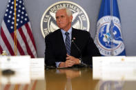 Vice President Mike Pence listens during a briefing about the upcoming presidential inauguration of President-elect Joe Biden and Vice President-elect Kamala Harris, at FEMA headquarters, Thursday, Jan. 14, 2021, in Washington. (AP Photo/Alex Brandon, Pool)