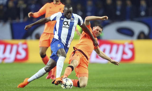 Liverpool's James Milner (right) tackles Moussa Marega in the 5-0 Champions League defeat of Porto.