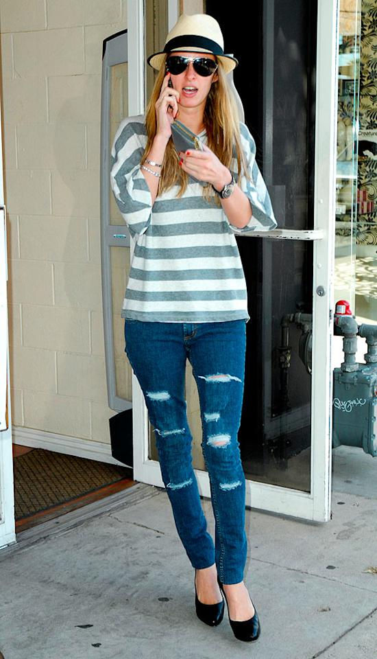 "Nicky Hilton pairs her ripped jeans with a funky fedora. EM/<a href=""http://www.x17online.com"" target=""new"">X17 Online</a> - February 26, 2009"