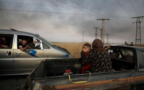 <span>Kurdish officials say the offensive has forced almost 200,000 people to flee their homes</span> <span>Credit: Rodi Said/Reuters </span>