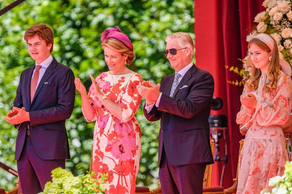 <p>The royals watch the parade from a special enclosure, which featured stylish floral arrangements.</p>