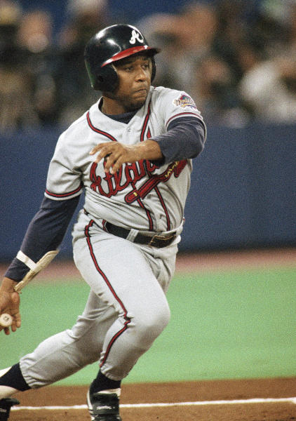 "FILE - In this Oct. 22, 1992, file photo, Atlanta Braves' Terry Pendleton watches an RBI double against the Toronto Blue Jays in the first inning of Game 5 of the baseball World Series in Toronto. ""I've always thought about that, why is that still on there?"" Pendleton said, speaking of Kenesaw Mountain Landis' name on the MVP trophy. ""No doubt, MVP stands on its own. It doesn't need a name."" (AP Photo/Rusty Kennedy, File)"