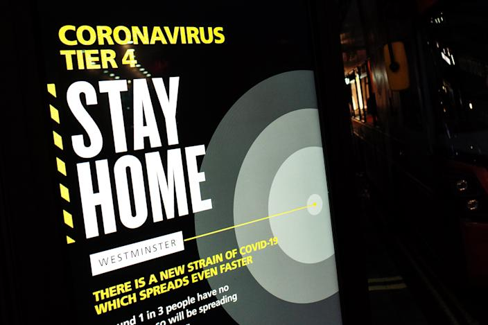 A notice informing people of 'Tier 4' coronavirus restrictions lights up a digital advertising screen on Oxford Street in London, England, on December 21, 2020. London spent its second day of what could be months under the newly-introduced Tier 4 restrictions today. Under Tier 4 rules non-essential shops and many other businesses including gyms and hairdressers must close, with people instructed to stay at home other than for exempted circumstances including travel to work or education. Indoor mixing between those in different households is also banned under the new tier, upending Christmas plans for a huge swathe of the population. Concern over a more infectious strain of the coronavirus in the UK has meanwhile seen dozens of countries ban arrivals from Britain, with food supplies also disrupted after France closed the cross-Channel freight route from Dover. (Photo by David Cliff/NurPhoto via Getty Images)