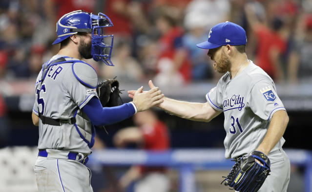 Kansas City Royals relief pitcher Ian Kennedy, right, is congratulated by catcher Cam Gallagher after the Royals defeated the Cleveland Indians 1-0 in a baseball game, Saturday, July 20, 2019, in Cleveland. (AP Photo/Tony Dejak)