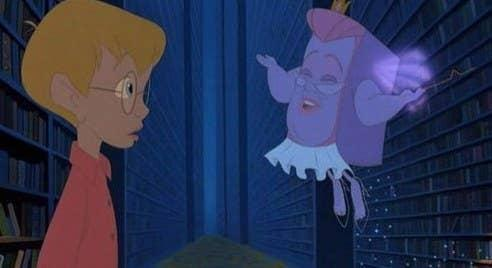 An animated Richard looks at Fantasy, the talking book, in The Pagemaster