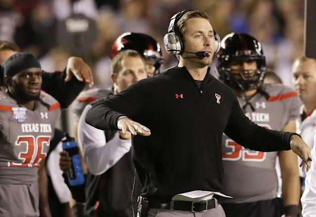 Texas Tech coach Kliff Kingsbury sends signals to his team during the first half of the Holiday Bowl NCAA college football game against Arizona State Monday, Dec. 30, 2013, in San Diego. (AP Photo/Gregory Bull)