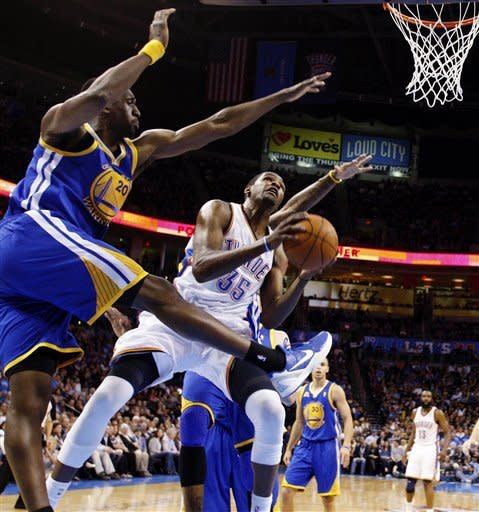 Oklahoma City Thunder forward Kevin Durant (35) shoots in front of Golden State Warriors forward Ekpe Udoh (20) in the first quarter of an NBA basketball game in Oklahoma City, Friday, Feb. 17, 2012. (AP Photo/Sue Ogrocki)