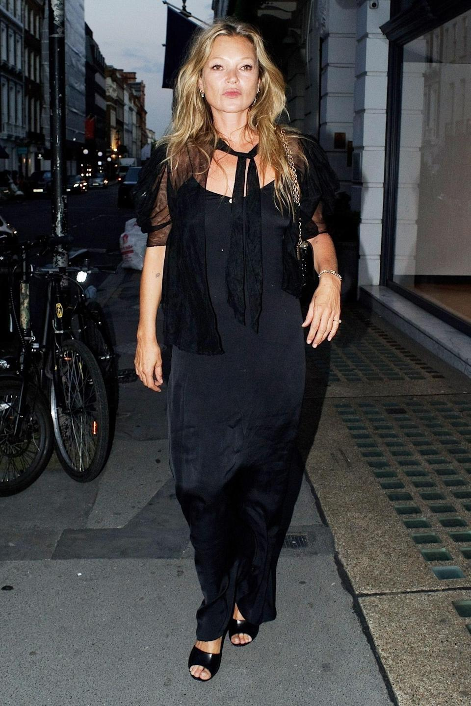 <p>Kate Moss wears all black to a party in Mayfair, London on July 19.</p>