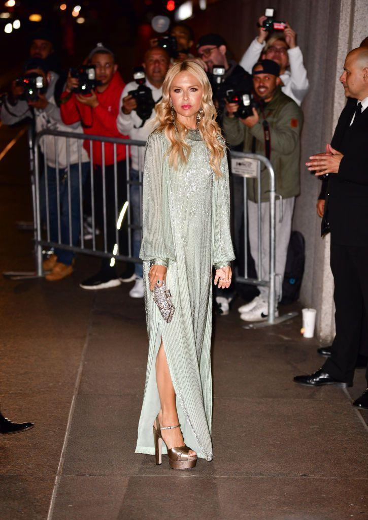 <p>The fashion designer wore a shimmering tea green dress.</p>