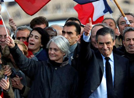 Francois Fillon, former French prime minister, member of The Republicans political party and 2017 presidential election candidate of the French centre-right and his wife Penelope attend a meeting in Paris