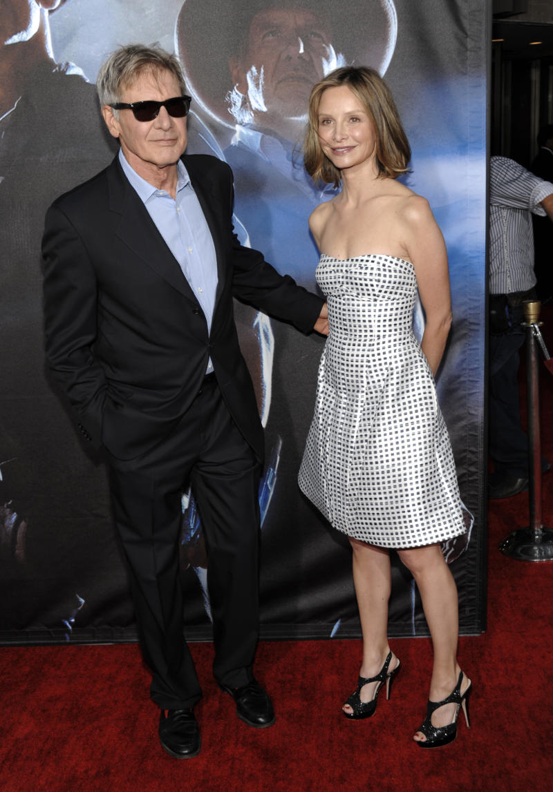 """Actor Harrison Ford, left, and actress Calista Flockhart arrive at the premiere of the feature film """"Cowboys and Aliens"""" at Comic Con in San Diego, Calif. on Saturday, July 23, 2011. (AP Photo/Dan Steinberg)"""