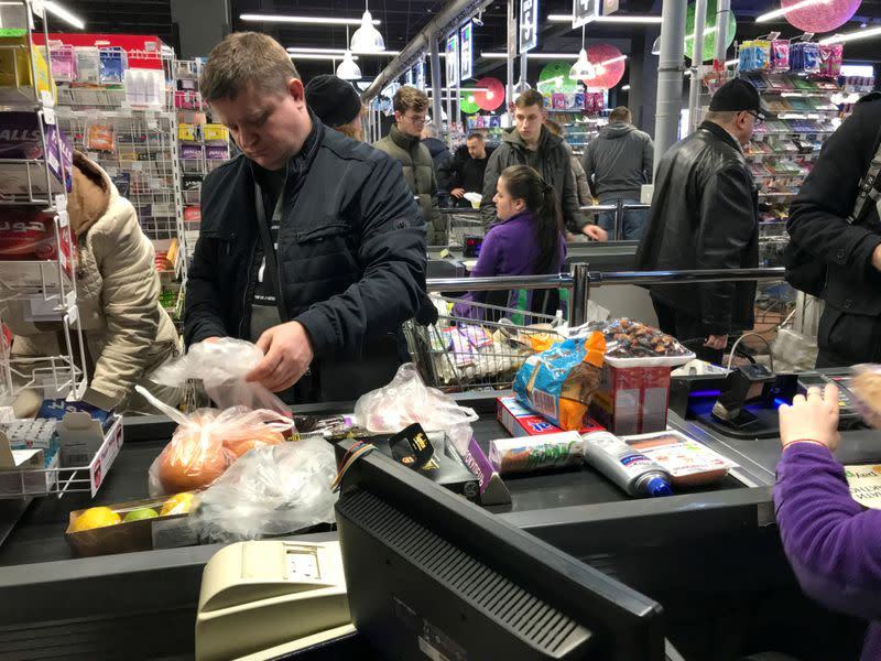 FILE PHOTO: Customers visit a supermarket in Kiev