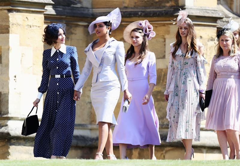Abigail Spencer and Priyanka Chopra arrive at the wedding of Prince Harry to Ms Meghan Markle at St George's Chapel, Windsor Castle on May 19, 2018 in Windsor, England.