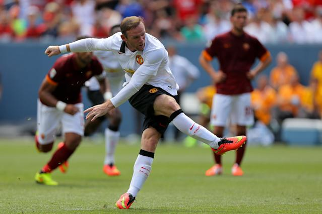 Manchester United's Wayne Rooney scores from the penalty spot during a 3-2 International Champions Cup win against AS Roma at Sports Authority Field at Mile High on July 26, 2014 in Denver, Colorado (AFP Photo/Justin Edmonds)