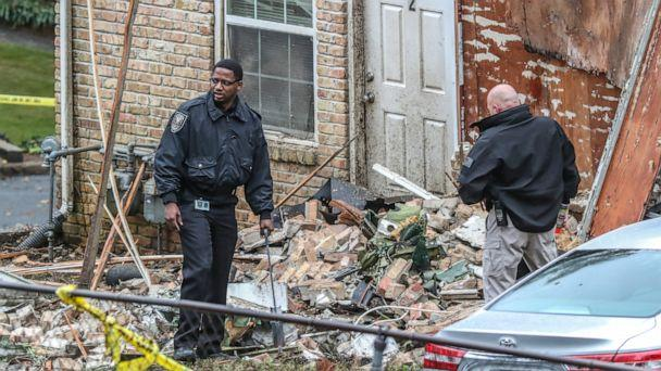 PHOTO: Officials look at the scene where an airplane crashed into an apartment complex, Oct. 30, 2019, in Atlanta. (John Spink/Atlanta Journal-Constitution via AP)