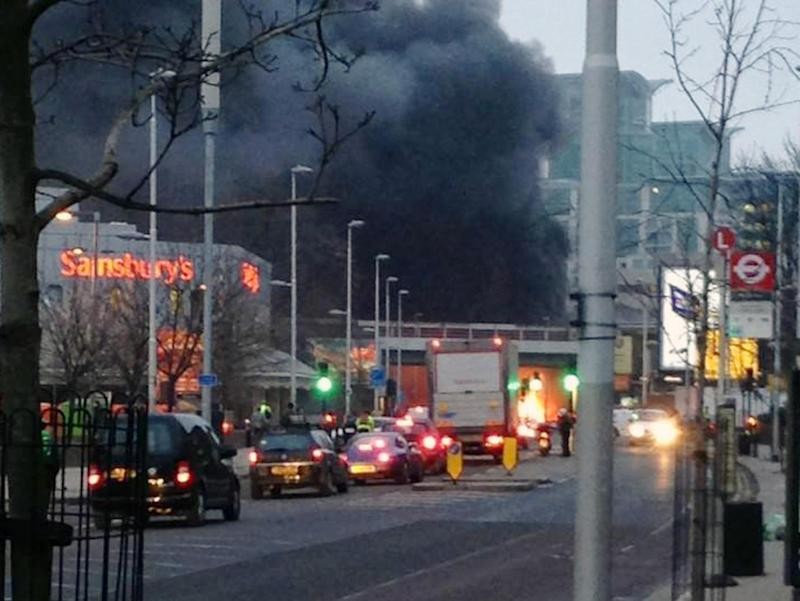 Smoke billows from the scene following a helicopter crash in central London, after it hit a crane on St. George's Tower building in the Vauxhall area of central London, Wednesday Jan. 16, 2013.  Police say two people were killed when a helicopter crashed during rush hour in central London after apparently hitting a construction crane on top of a building, obscured behind smoke. (AP Photo/Max James Tolhurst, PA) UNITED KINGDOM OUT - NO SALES - NO ARCHIVES