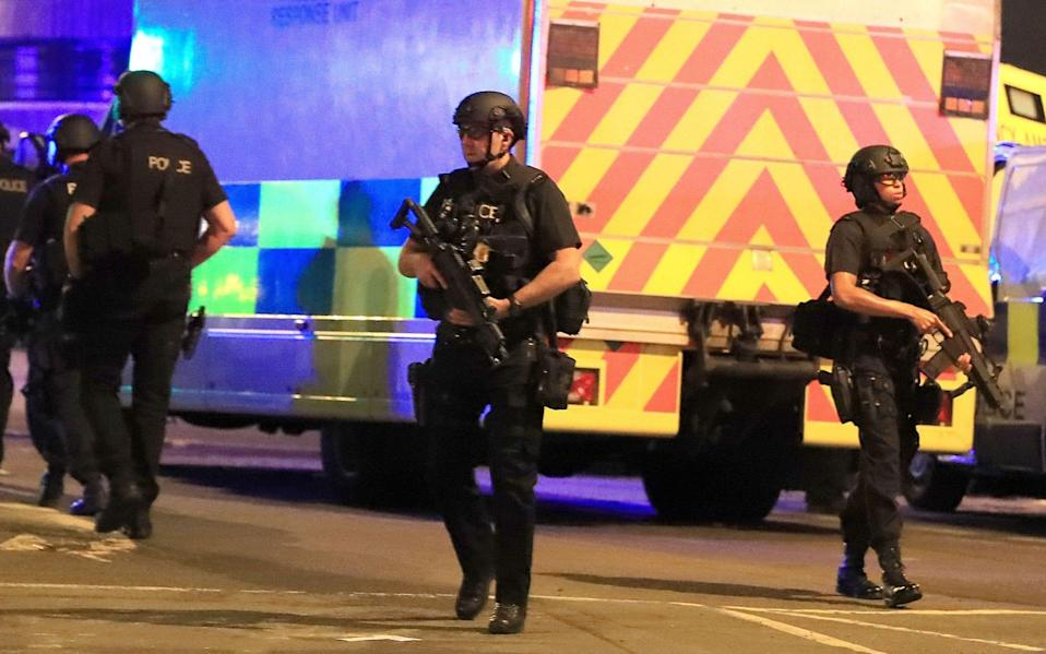 Armed police at Manchester Arena - Credit: PA