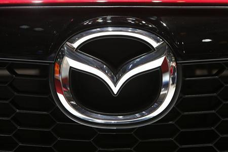 The company logo is seen on the bonnet of a Mazda car during the media day ahead of the 84th Geneva Motor Show at the Palexpo Arena in Geneva