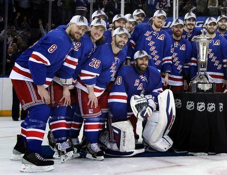 New York Rangers goalie Henrik Lundqvist (30), right wing Martin St. Louis (26) and the rest of the Rangers pose with the Prince of Whales trophy after defeating the Montreal Canadiens in game six of the Eastern Conference Final of the 2014 Stanley Cup Playoffs at Madison Square Garden. Mandatory Credit: Adam Hunger-USA TODAY Sports