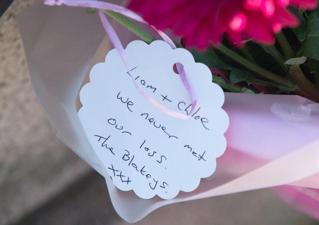 Flowers laid outside South Shields town hall, the home town of victims Chloe Rutherford and Liam Curry (Tom White/PA)