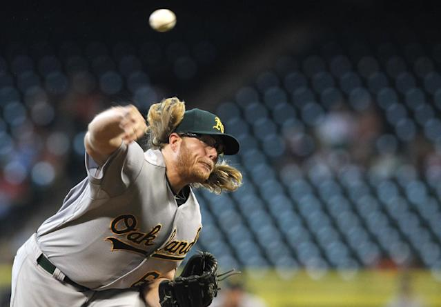 Oakland Athletics starting pitcher A.J. Griffin (64) throws in the first inning of a baseball game against the Houston Astros, Wednesday, July 24, 2013, in Houston. (AP Photo/Patric Schneider)