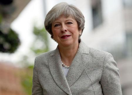Theresa May arrives back at the Midland Hotel on the opening day of the Conservative Party Conference, in Manchester, Britain October 1, 2017. REUTERS/Hannah McKay