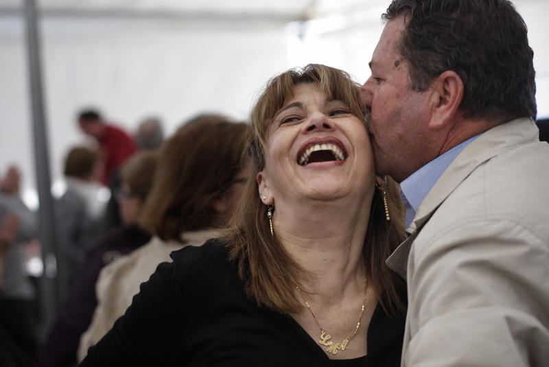 In this photo taken Saturday April 21, 2012, a couple kiss after a dance during a meeting between men and women at the village of Candeleda, central Spain. 68 women were bussed in to the village to meet with the local men with the hope that some will form relationships and settle in the village where the main population is male.  (AP Photo/Alberto Di Lolli)