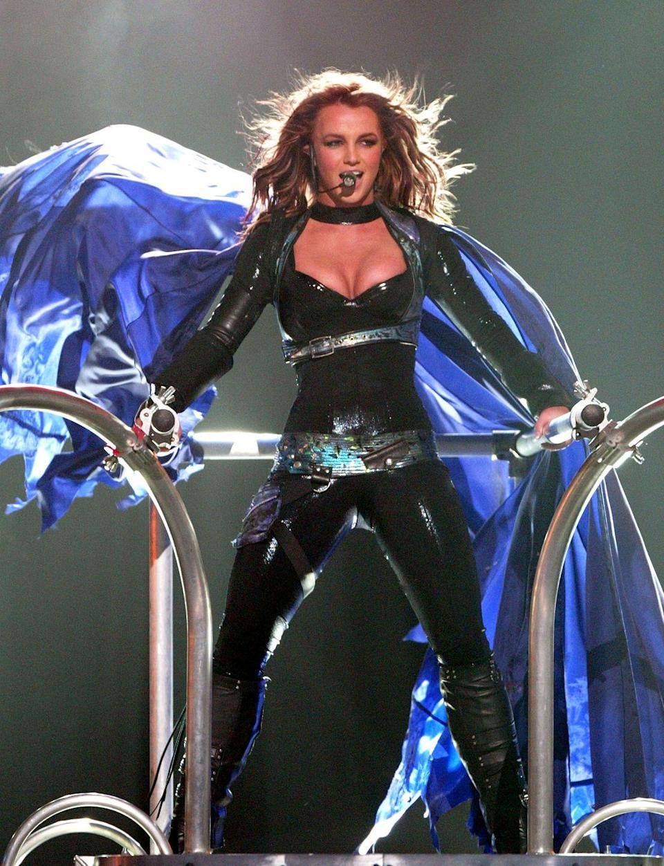 <p>Britney Spears performs during her Onyx Hotel tour on March 28, 2004 in Miami, Florida. </p>