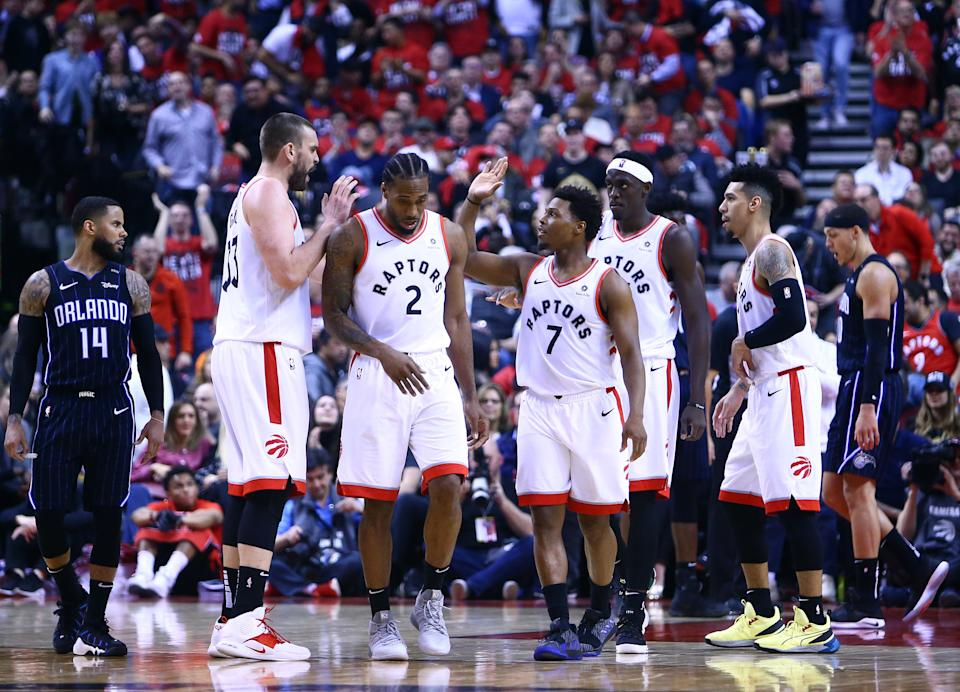 Kyle Lowry (7) of the Toronto Raptors high fives Marc Gasol (33) during Game 2. (Photo by Vaughn Ridley/Getty Images)