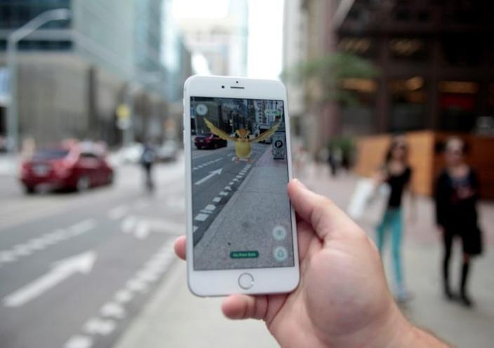 """A Pidgey is displayed on the screen of the """"Pokémon Go"""" mobile app. (Photo: Chris Helgren/Reuters)"""