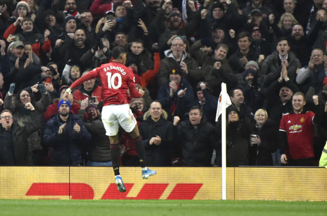 Manchester United's Marcus Rashford celebrates after scoring his side's second goal during the English Premier League soccer match between Manchester United and Tottenham Hotspur at Old Trafford in Manchester, England, Wednesday, Dec. 4, 2019. (AP Photo/Rui Vieira)