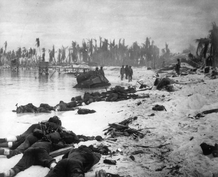 FILE - In this Nov. 1943 file photo, sprawled bodies are seen on the beach of Tarawa atoll testifying to the ferocity of the battle for this stretch of sand during the U.S. invasion of the Gilbert Islands. A nonprofit organization that searches for the remains of U.S. servicemen lost in past conflicts has found what officials believe are the graves of more than 30 Marines and sailors killed in one of the bloodiest battles of World War II. (AP Photo, FILE)