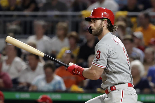 Philadelphia Phillies' Bryce Harper watches his RBI-single off Pittsburgh Pirates relief pitcher Richard Rodriguez during the seventh inning of a baseball game in Pittsburgh, Friday, July 19, 2019. (AP Photo/Gene J. Puskar)