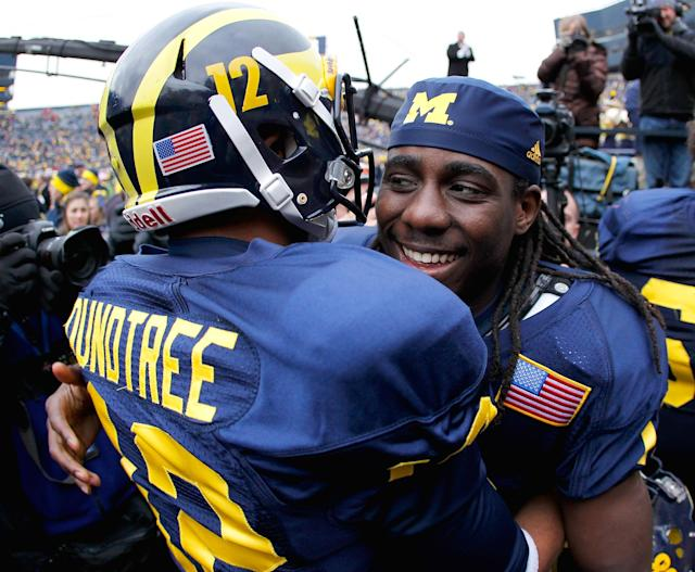ANN ARBOR, MI - NOVEMBER 19: Denard Robinson #16 of the Michigan Wolverines celebrates a 45-17 victory over the Nebraska Cornhuskers with Roy Roundtree #12 at Michigan Stadium on November 19, 2011 in Ann Arbor, Michigan. (Photo by Gregory Shamus/Getty Images)