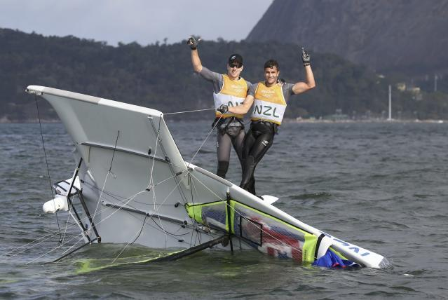 2016 Rio Olympics - Sailing - Final - Men's Skiff - 49er - Medal Race - Marina de Gloria - Rio de Janeiro, Brazil - 18/08/2016. Peter Burling (NZL) of New Zealand and Blair Tuke (NZL) of New Zealand celebrate gold medal. REUTERS/Benoit Tessier TPX IMAGES OF THE DAY FOR EDITORIAL USE ONLY. NOT FOR SALE FOR MARKETING OR ADVERTISING CAMPAIGNS.