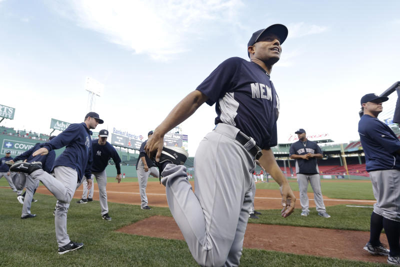 New York Yankees relief pitcher Mariano Rivera, front, stretches before a baseball game against the Boston Red Sox at Fenway Park, in Boston, Sunday, Sept. 15, 2013. (AP Photo/Steven Senne)