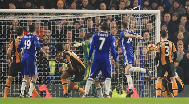 <p>The England centre-back swoops to seal the three points for Chelsea </p>
