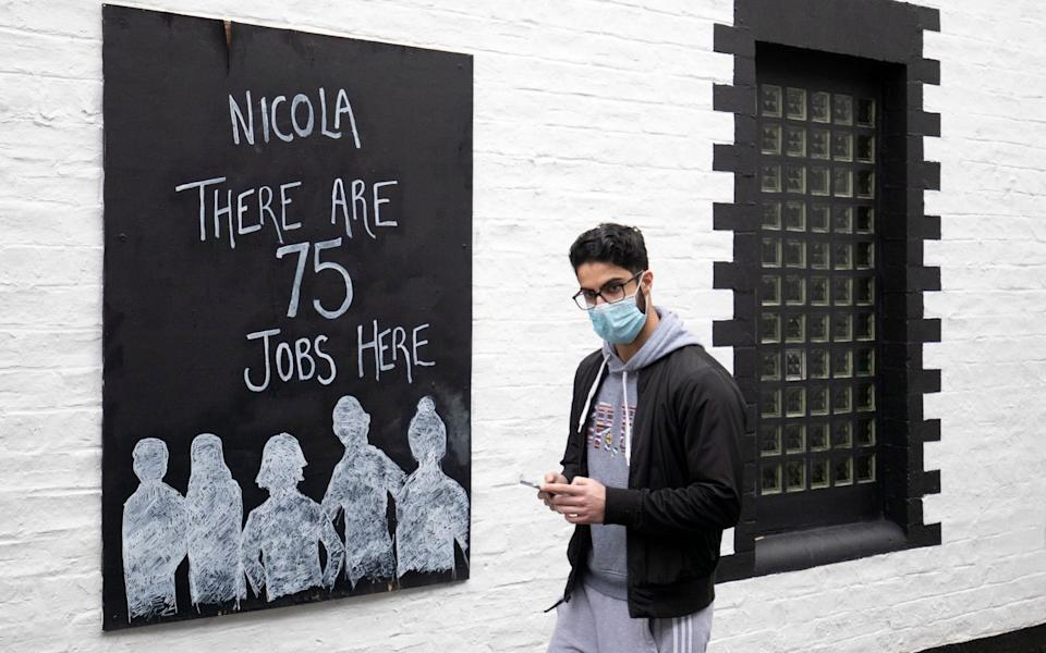 "A poster that reads ""Nicola there are 75 jobs here"" was displayed outside the Ubiquitous Chip restaurant in the West End of Glasgow - PA"