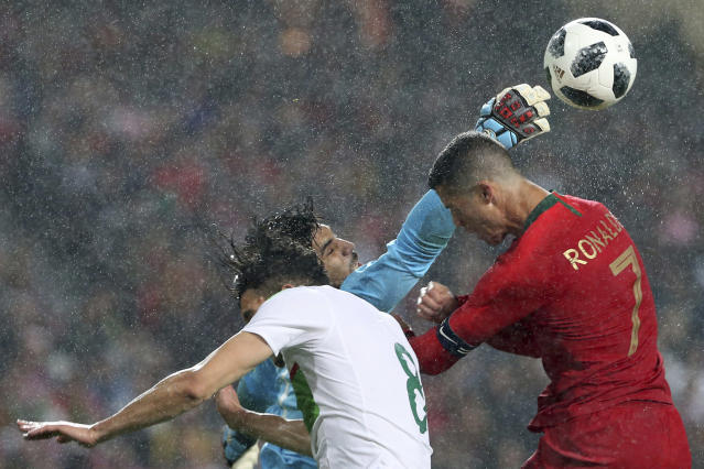 Algeria goalkeeper Abdelkaadir Salhi, makes to save headshot of Portugal's Cristiano Ronaldo during a friendly soccer match between Portugal and Algeria in Lisbon, Portugal, Thursday, June 7, 2018. (AP Photo/Armando Franca)