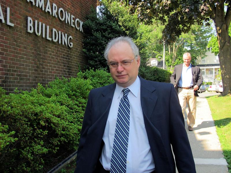 Rabbi Alfredo Borodowski arrives for an appearance in Mamaroneck Village Court in Mamaroneck, N.Y. on Thursday, July 18, 2013. Borodowski pleaded not guilty to impersonating a police officer. He allegedly flashed a badge and ordered a motorist to pull over. (AP Photo/Jim Fitzgerald)