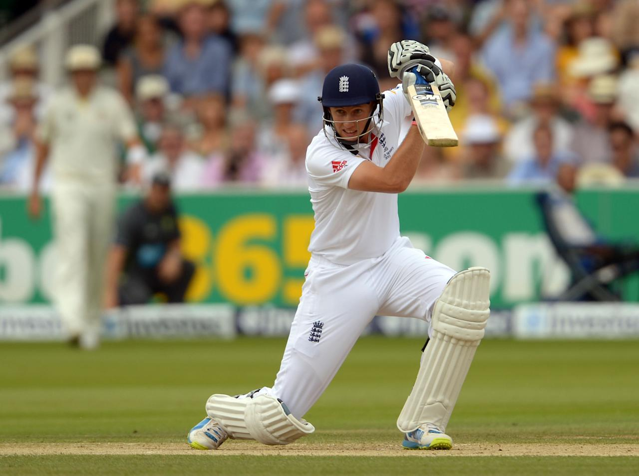 England's Joe Root hits out for four runs on day three of the Second Investec Ashes Test at Lord's Cricket Ground, London.